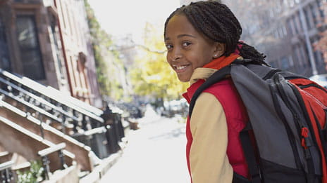 Girl with backpack photo